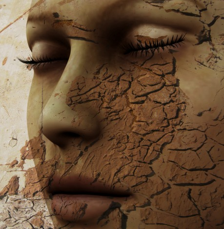 Digital composition of a female face / one of four elements: earth