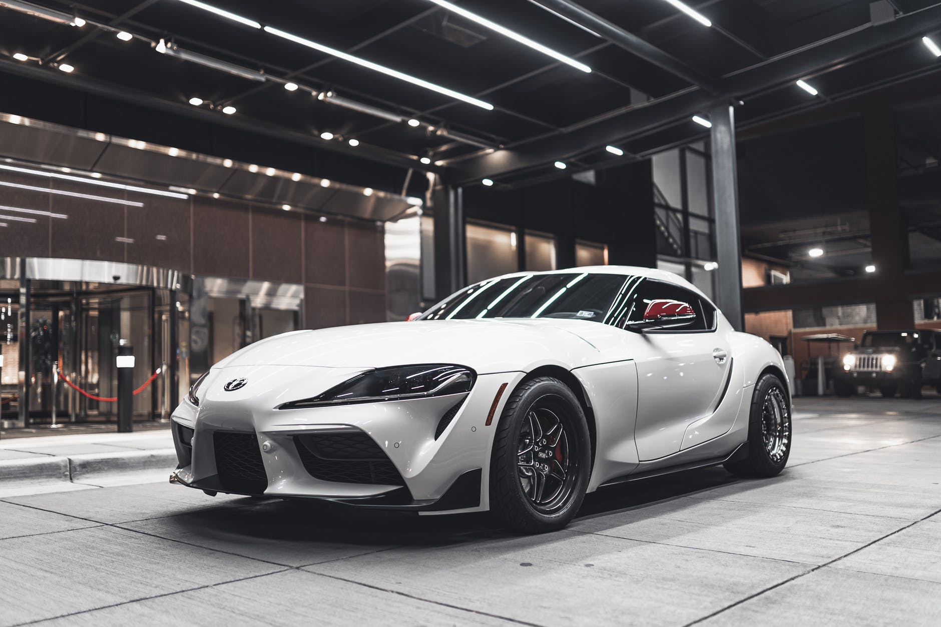 photo of supra parked in front of building